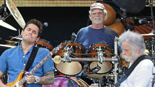 Drummer Bill Kreutzmann performs with guitarists John Mayer (left) and Bob Weir (right) during Friday's Dead and Company show at Klipsch Music Center. Kreutzmann and Weir were co-founding members of the Grateful Dead in 1965.