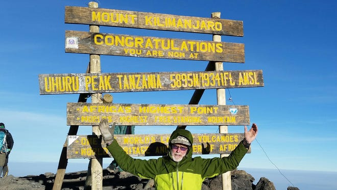 Marty Bannon makes it to the summit at Mount Kilimanjaro.