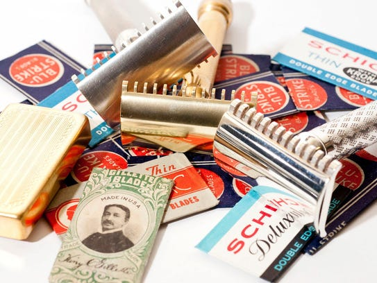 A collection of vintage safety razors and vintage double