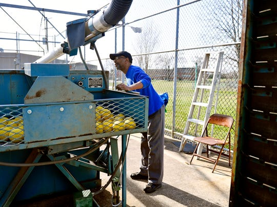 Louis Woodyard checks over the machines on the first day the batting cages opened Thursday, April 12, 2018, at Memorial Park in York. Woodyard, who works part-time for the city at the park and Voni Grimes Gym, was shot in a case of mistaken identity in October 2016. With help from friends, family and fellow musicians, Woodyard recovered physically but is still working through his Post-Traumatic Stress Disorder.