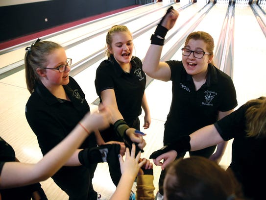 The Klahowya Secondary School bowling team gets pumped up as they get ready at the Olympic League championships at All-Star Lanes in Silverdale on Thursday.
