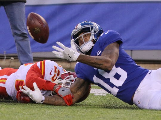 Kansas City Chiefs cornerback Phillip Gaines can't stop New York Giants wide receiver Roger Lewis from making this catch to set up the winning field goal in OT. The Giants thought he scored a touchdown when he got up nd ran the ball into the end zone but he was called down where he made the catch.