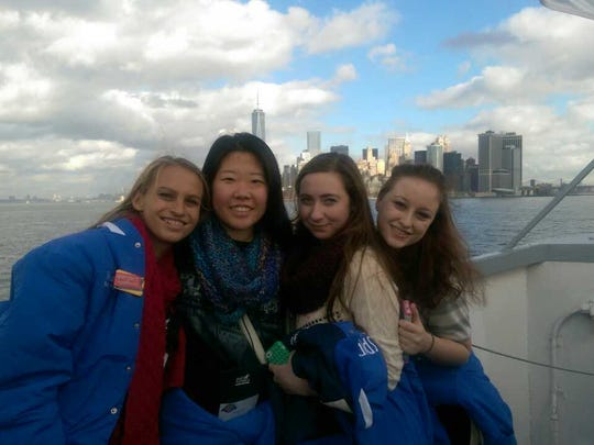 Roncalli dancers, from left, Matalie Koss, Claire Wang, Claire Krieger and Kristin Senglaub aboard the Statue of Liberty Harbor Cruise on Monday. The girls traveled to New York to perform in the Macy's Thanksgiving Day Parade on Thursday.