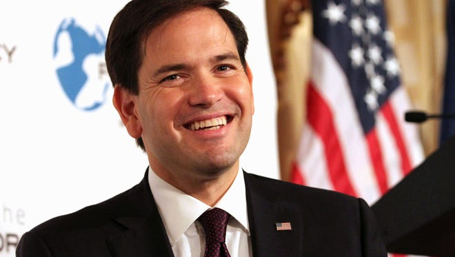Sen. Marco Rubio, R-Fla. smiles while speaking during an event hosted by the Foreign Policy Initiative.