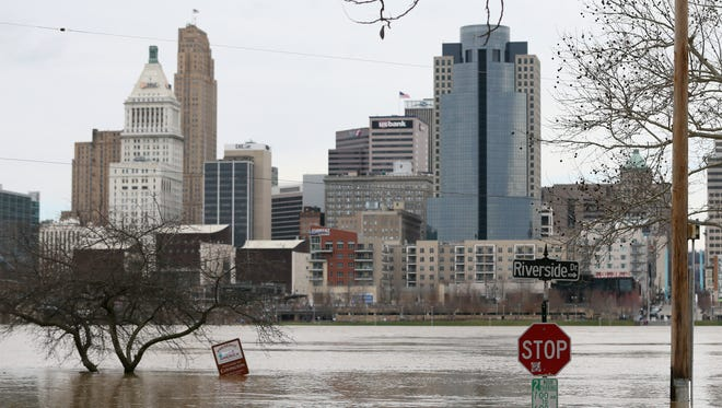 Viewing looking north to Cincinnati as flood waters rise toward the intersection of Riverside Drive and Garrard Street, Sunday, Feb. 25, 2018, in Covington, Ky. The Ohio River is expected to crest at 60.7 feet by Sunday evening, according to the National Weather Service. The river rose above the 60 feet mark for the first time in two decades Sunday morning.