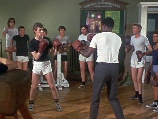 Sidney Poitier and Christian Roberts square off with boxing gloves in 'To Sir, with Love.'