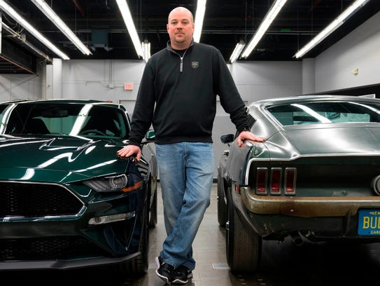 """Sean Kiernan of Hendersonville, Tennessee (just outside Nashville) is the owner of the """"Bullitt"""" car. He is photographed with the 2019 Ford Mustang Bullitt on the left and the 1968 Ford Mustang Fastback from the 1968 movie Bullitt on the right."""