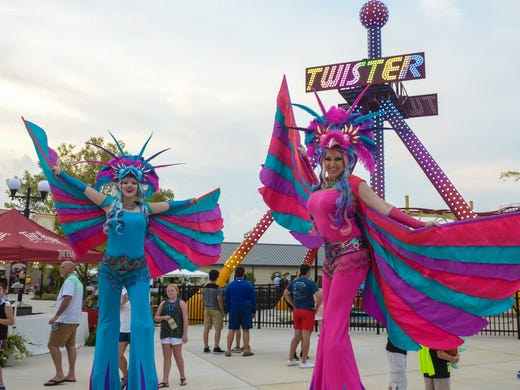 Stilt walkers entertain guests during the Media Night