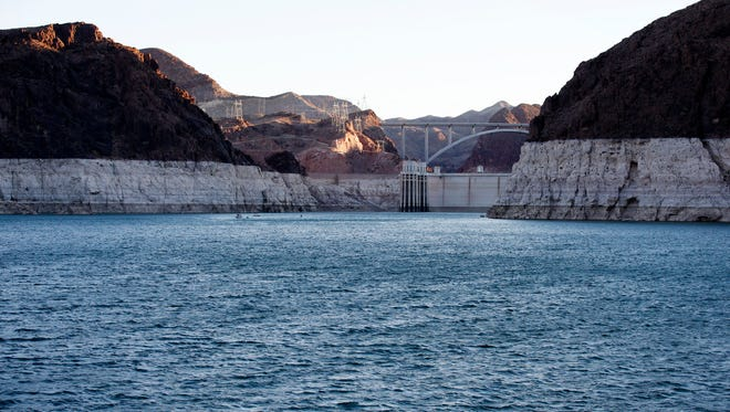 A light band of rock shows the high-water line near Hoover Dam on Lake Mead in Nevada.
