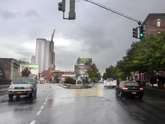 Main Street and Huguenot Street become one way streets in different directions at Pintard Avenue in New Rochelle. The city is considering converting both streets to two-way for the first time since 1951.