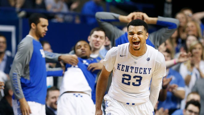 Kentucky's Jamal Murray celebrates after knocking down a  three and then using is  arrow celebration to take out teammate EJ Foreal.  