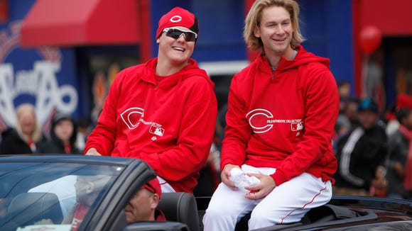 Mat Latos (left) and Bronson Arroyo ride in a car during the 2013 Opening Day parade.