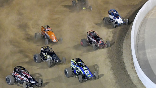 "Racers look for a ""clean"" line in the dirt Saturday during the opener at Mansfield Motor Speedway."
