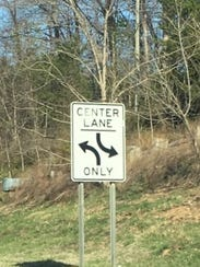 The center turn lane is clearly marked for turning