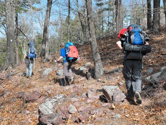 Hikers on the Ozark Trail negotiate a rocky hillside.