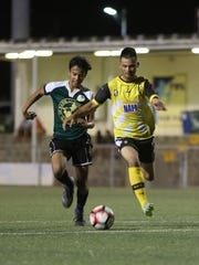 NAPA Rovers' Ashton Surber takes the ball past Bank of Guam Strykers D2's Robert Niu to the goal in a Round 1 match of the Bank of Guam 10th Annual GFA Cup men's soccer tournament Tuesday May 2, 2017, at the Guam Football Association National Training Center. The Rovers won 9-1.