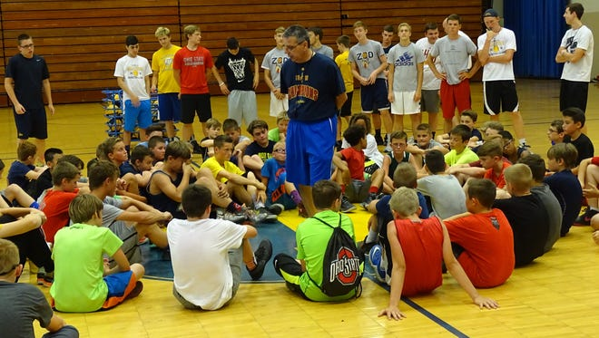 New Lancaster boys basketball coach Kent Riggs talks addresses players during the Gale Force Basketball Camp on Tuesday.