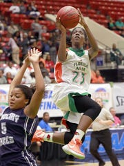 FAMU DRS (23) Jazmine Jones goes up for a shot over Academy at the Lakes (5) Loren Wells during the FHSAA 2A Girls State Championship Basketball Game at the Lakeland Center in Lakeland, Florida February 17, 2016. The Ledger/Pierre DuCharme