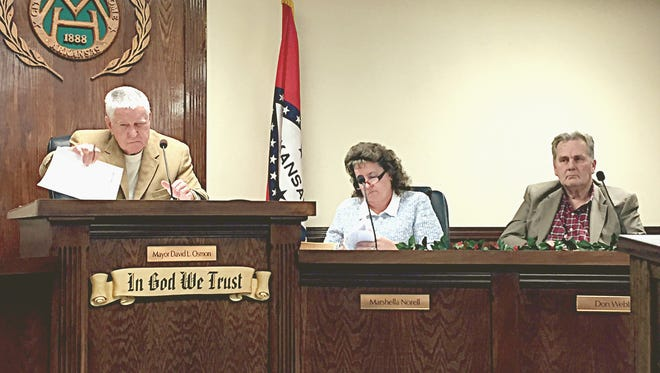 Mayor David Osmon and Aldermen Marshella Norell and Don Webb listen as a proposed sewer rate increase ordinance is read.