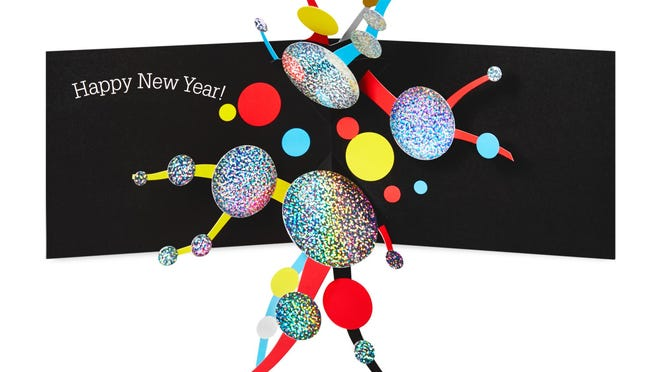 Children's book author and artist David Carter's New Year's card is a joyful, festive explosion of abstract shapes and pop up paper construction.