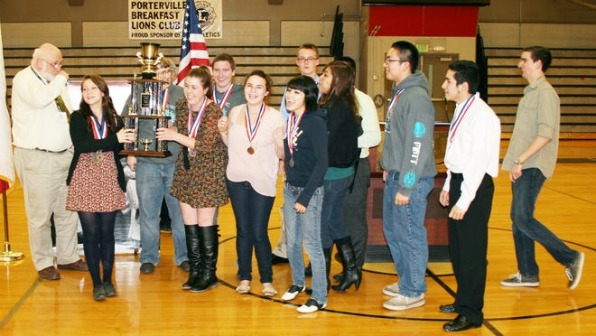 Team members from Harmony Magnet Academy in Strathmore gather to accept top honors at the Academic Decathlon in the Porterville College gym in 2012.