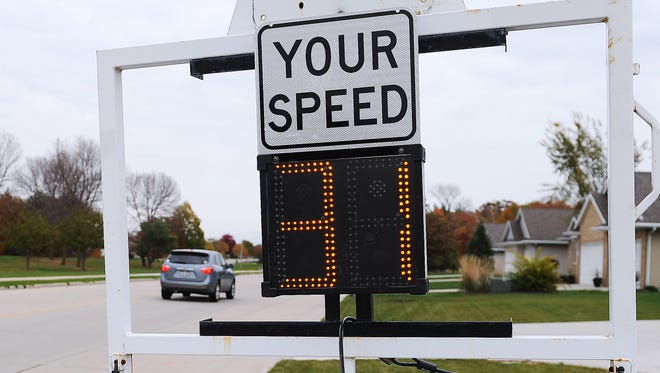 A Green Bay Police Department mobile speed warning sign registers the speed of vehicles on Sitka Street on the city's northeast side.