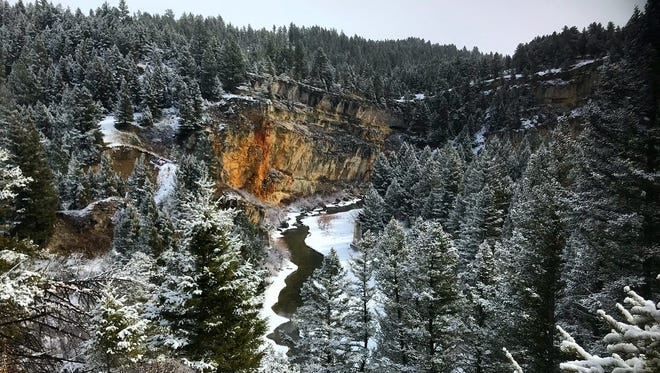 Partially frozen Belt Creek runs through the slot canyon at Sluice Boxes State park near Belt.