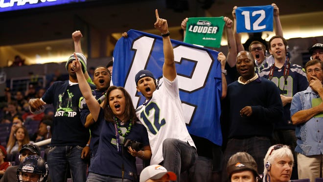 Seattle Seahawks fans cheer on their team at Super Bowl XLIX media day on Tuesday, Jan. 27, 2015, at US Airways Center in Phoenix.