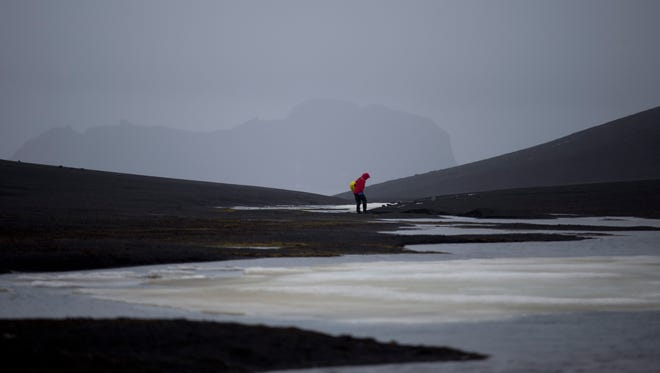 An international scientist collects samples in the South Shetland Islands archipelago Antarctica.