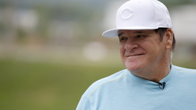 Former Reds great Pete Rose chats with Enquirer columnist Paul Daugherty (not pictured) on June 2.
