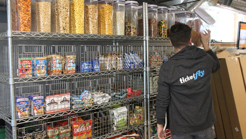 The snack options at the San Francisco office of Ticketfly, shown from 2015, include cereal, energy bars, crackers, chips, bananas, nuts, chocolate and candy.