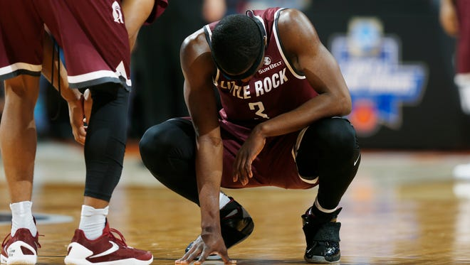 Arkansas Little Rock guard Josh Hagins reacts as time runs out against Iowa State in the second half of a second-round NCAA tournament game Saturday at the Pepsi Center in Denver. Iowa State beat the Trojans 78-61.