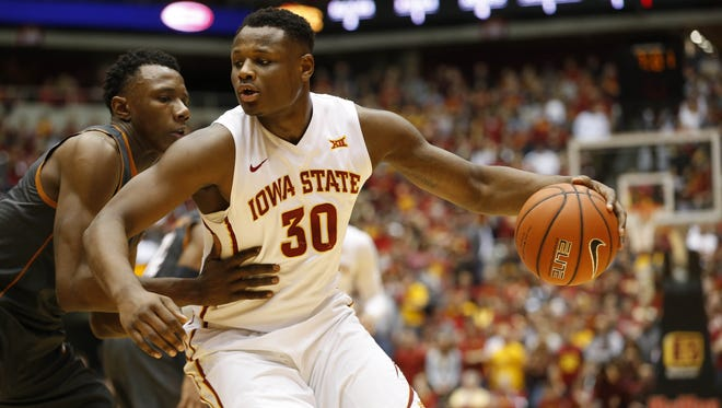 Iowa State guard Deonte Burton (30) tries to push past Texas Saturday, Feb. 13, 2016, at Hilton Coliseum in Ames.