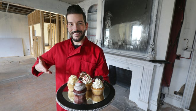 Owner Ryan Swift inside Sinful Sweets, located at the corner of Park Avenue and Alexander Street.