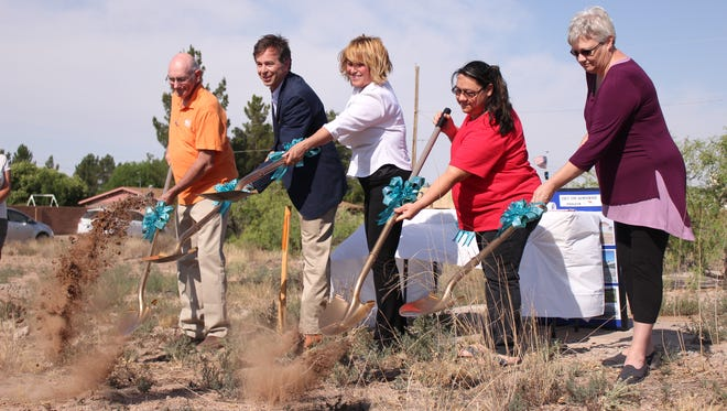 From left, Barney Ingram, Terry Brunner, Veronika Molina, Myra Flores and Cindy Strong break ground for the new houses being built with the assistance of the USDA Rural Development's Self Help housing program.The ceremony took place early Friday morning at the lots where the houses are to be built.