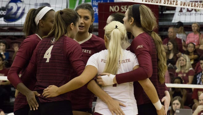 Milica Kubura (7) speaks to the team as they huddle up during FSU's 3-0 win over Arkansas Little-Rock.