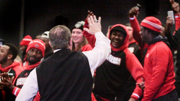 UL coach Mark Hudspeth celebrates a New Orleans Bowl invite with Ragin' Cajun players.
