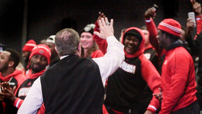 UL coach Mark Hudspeth celebrates a New Orleans Bowl invite with Ragin' Cajun players.