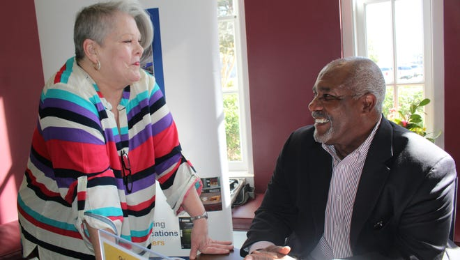 Former Auburn University football trailblazer Thom Gossom Jr. chats with Ann King prior to his appearance at the Selma-Dallas County Library Thursday.