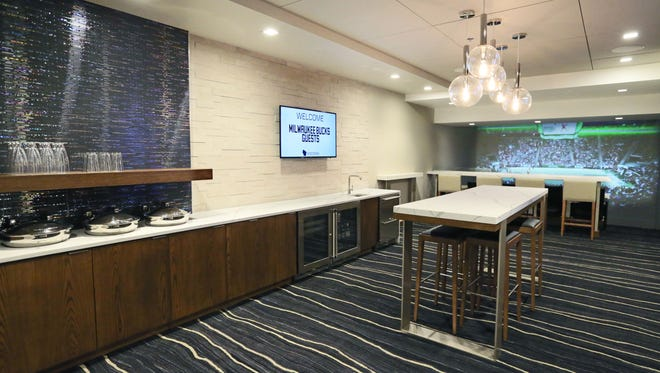 A mock suite shows what the luxury suites planned for the new Milwaukee Bucks arena look like.