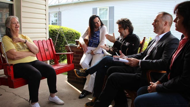 """In this image provided by Spike TV, Ruth Sayre, left, meets with Angela Clemente, Joe Berlinger, Steve Bongardt and an unidentified person during filming of """"Gone:The Forgotten Women of Ohio."""" The show begins at 9 p.m. July 22 on SpikeTV."""