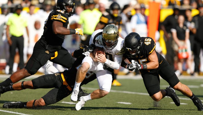 Linebacker Eric Boggs (45) leads the Appalachian State defense into its game against Coastal Carolina.