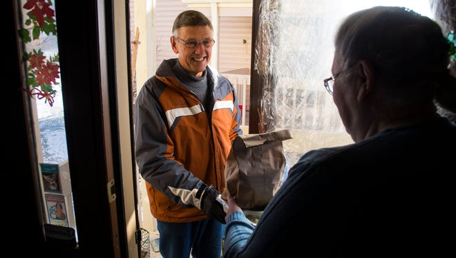 Jack Zimmer delivers a meal to Martha Scott for Meals On Wheels.