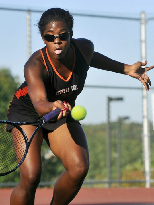 Central York's Yvonne Peters-Washington returns a shot during her 6-0, 6-1 victory against New Oxford's Dagney Markle to win the YAIAA Class AAA championship on Monday at South Western. It was the first YAIAA tournament for Peters-Washington, who moved to York County from the State College area in April.