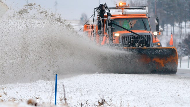 A snowplow clears snow off of Interstate 80 near  Earlham, Iowa, Tuesday, Feb. 2, 2016.