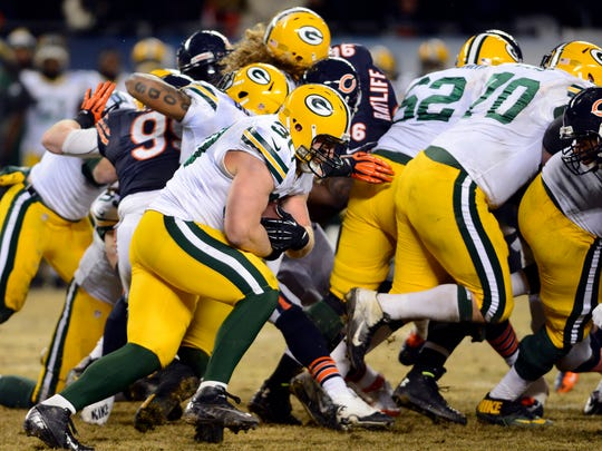 John Kuhn (30) picks up a crucial first down on last December's final drive against the Chicago Bears.