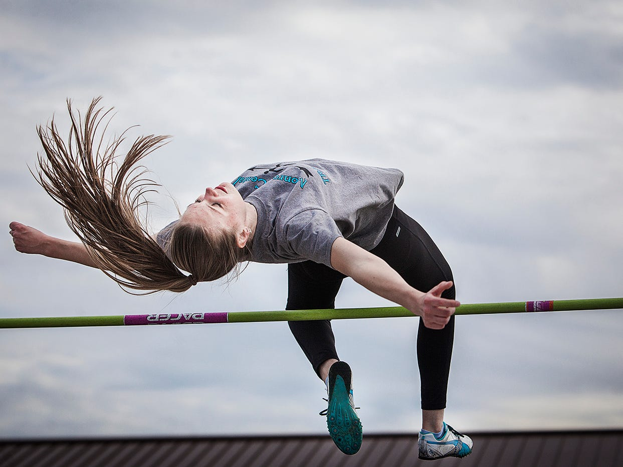 Monroe Central's Megen Yates tries to clear the high-jump bar in a recent practice.