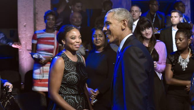President Obama greets guests after taking part in a town hall discussion hosted by ABC at the Studio Theater Thursday in Washington.