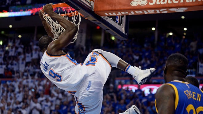 Oklahoma City Thunder forward Serge Ibaka (9) dunks the ball during the first quarter against the Golden State Warriors in Game 3.