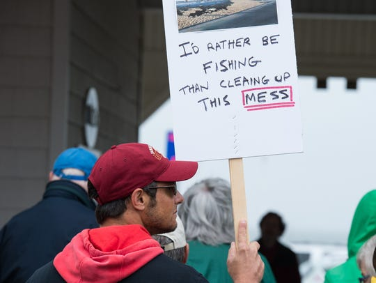 A man holds a sign as part of the March for Science